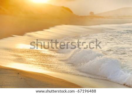 Sun rising over foggy ocean in Carmel, California - stock photo