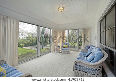 Sun room in suburban home with patio view - stock photo