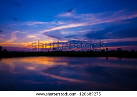 sun set and blue sky on river - stock photo