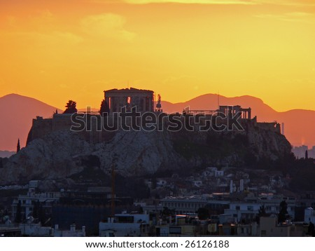 Sun set over the Acropolis with an orange sky in the backround