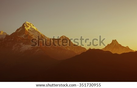 Sun set scene over Mountains In Nepal Himalaya. Red brown color - stock photo
