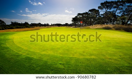 Sun sets after a great round of golf - stock photo