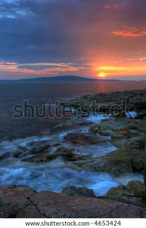 Sun sets along the Maine Coast in Acadia National Park - stock photo