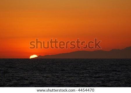 Sun sets at the edge of Santa Monica Bay in southern California