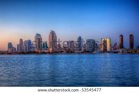 Sun setting lights up the buildings on San Diego seafront in HDR - stock photo