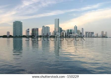 Sun Setting on Miami Skyline - stock photo