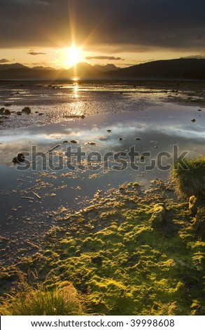 Sun setting over River Clyde at Cardross near Glasgow in Scotland - stock photo
