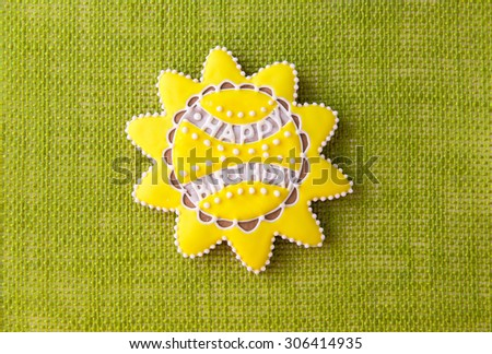 Sun shaped cookie with Happy Birthday writing. - stock photo