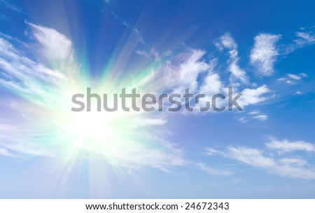 Sun shine over clouds on blue sky