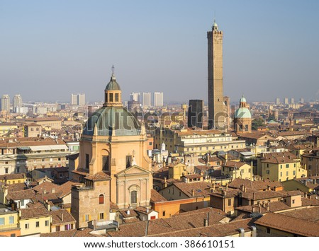 sun shining day above the roofs in italian city - stock photo