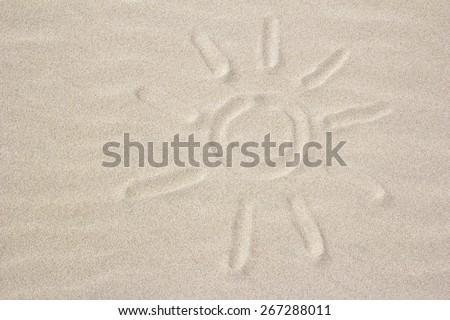 sun sign on the sand - stock photo