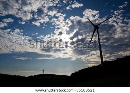 sun, sky and wind mills - stock photo