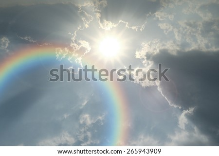 Sun sky cloud rainbow - stock photo