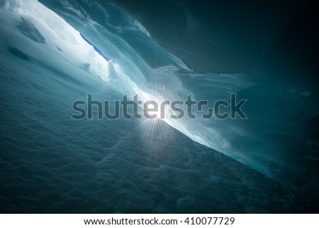 Sun star from deep within a Crevasse on Blackcomb glacier - stock photo