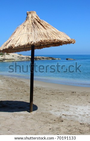 sun umbrella on the beach blue sky - stock photo