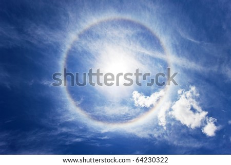 Sun with circular rainbow - sun halo occurring due to ice crystals in atmosphere