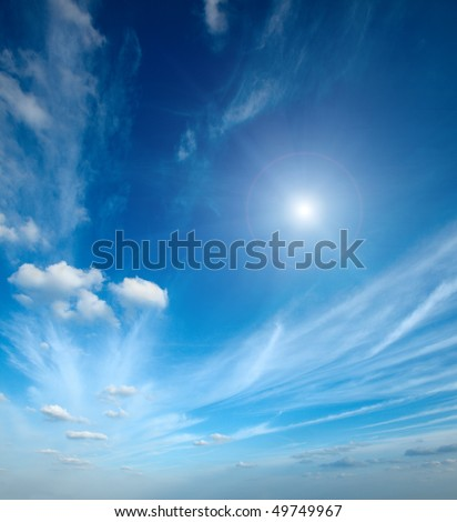 Sun with clouds in blue sky - stock photo