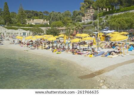 Sunbathers on beach on French Riviera, France - stock photo