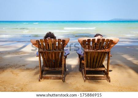 sunbathing on the beach - stock photo