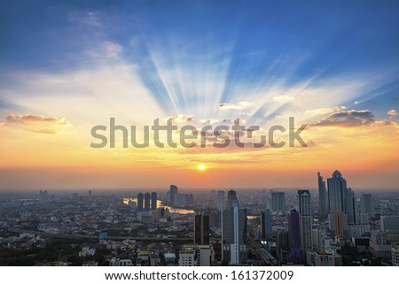 Sunbeam and cityscape at sunset in Bangkok, Thailand - stock photo