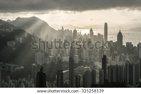 Sunbeam At Sunset On Top Of Mountain Peak Black And White - stock photo