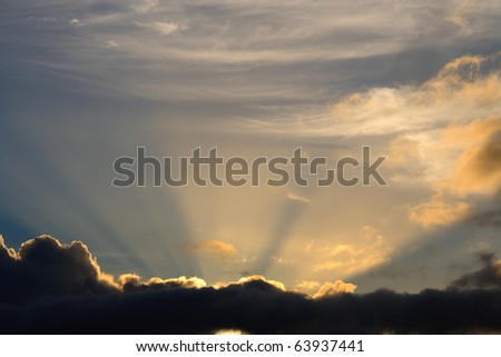 Sunbeam busts through clouds like a heavenly image of bright light - stock photo
