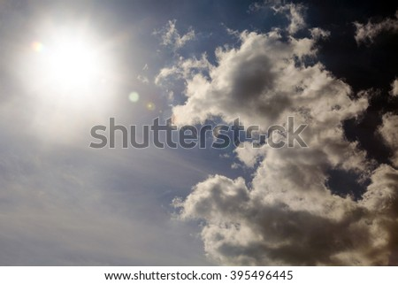 Sunbeam goes out in between clouds and day starts to rise slowly. - stock photo
