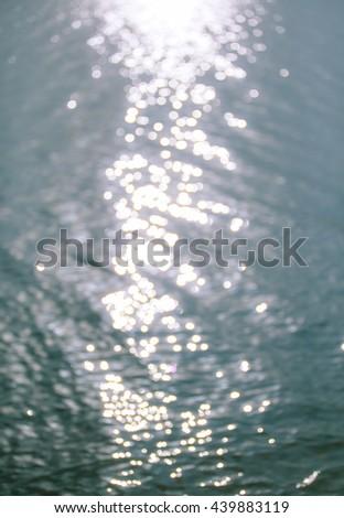 sunbeam on water surface - stock photo