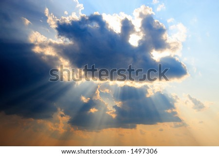 Sunbeam poking through the clouds. - stock photo