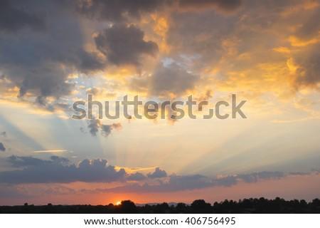 Sunbeam ray light over the orange sky - stock photo