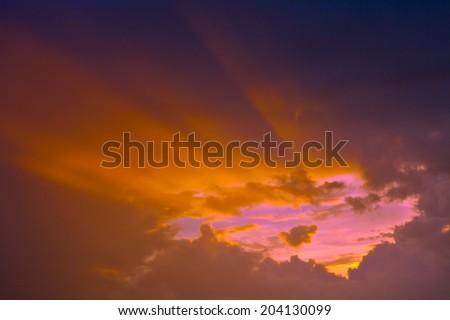 Sunbeam ray light shining through cloud sky at twilight. Dramatic background symbolizing spiritual heaven or hope of trust in god - stock photo