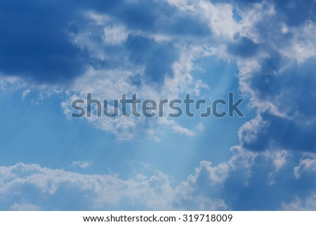 sunbeam through the cloud of sunlight in blue sky, abstract heaven light background - stock photo