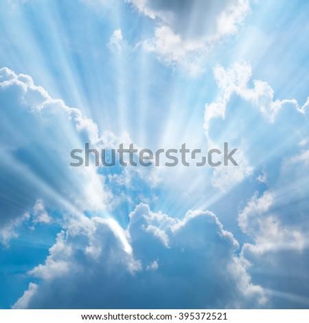 Sunbeam through the haze on blue sky - stock photo