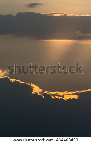 Sunbeam through the haze on blue sky: can be used as background and dramatic look, Ray of lights through the clouds - stock photo