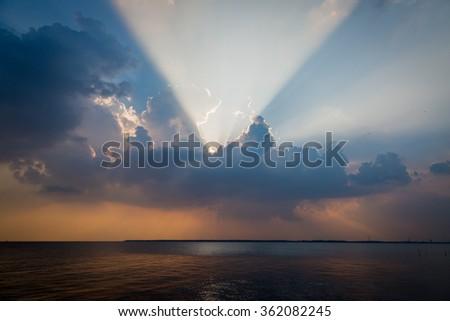 Sunbeam through the haze on blue sky use for background - stock photo