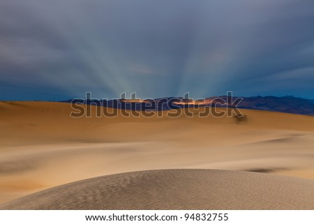 Sunbeams and desert. Image of Mesquite Dunes in Death Valley National Park, California, USA. - stock photo