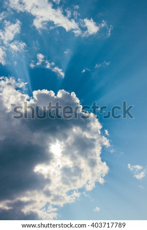 sunbeams breaking through the clouds - stock photo
