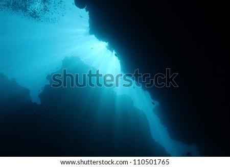 Sunbeams Breaking Through Underwater, Bunaken, Indonesia - stock photo