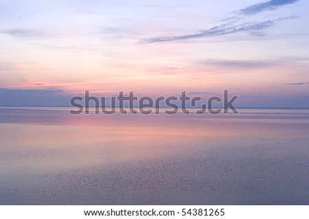 Sunbeams emanating from behind a clouds at surise - stock photo