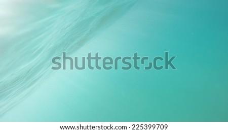 Sunbeams in blue deep sea or ocean underwater background  - stock photo