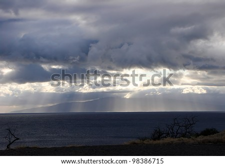 Sunbeams in Clouds at Dusk over Ocean - stock photo