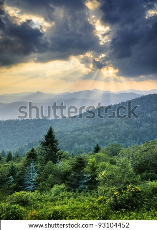 Sunbeams Light Rays Over Southern Appalachian Blue Ridge Mountains at dramatic summer sunset - stock photo