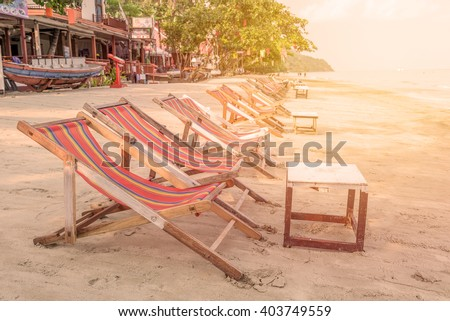 sunbed or chair on the tropical beach - stock photo
