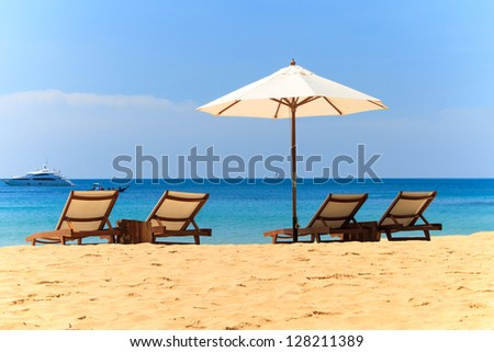 Sunbeds and umbrella on a tropical beach