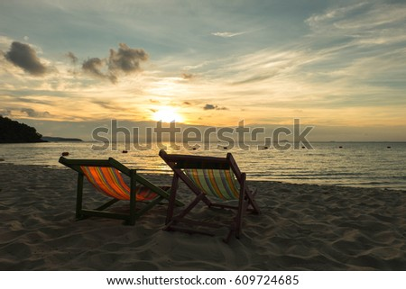 Sunbeds are on the beach in evening