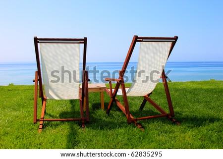 Sunbeds at the beach of luxury hotel, Crete, Greece - stock photo