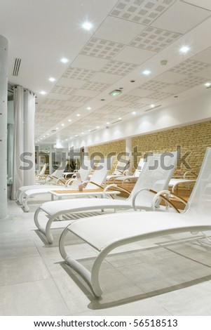 Sunbeds in the fitness (spa) near the ocean - Relax concept - stock photo