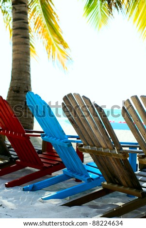 Sunbeds  on an exotic beach. Saona, Dominican Republic - stock photo