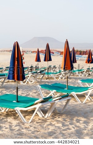 Sunbeds on beach