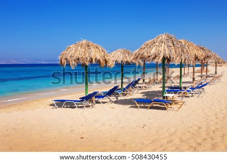 Sunbeds on Plaka beach, Naxos island, Greece